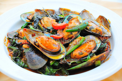 Yes, I was back there at CoCurry again. And yes, they taste better than they look. --- Basil Mussels