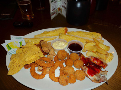 "Classic Combo Deluxe - Chipotle chilli chicken strips, duck spring rolls, onion rings, BBQ chicken wings, breaded murshrooms, cheesy garlic bread, potato wedges and tortilla chips. £9.75. Served in ""The Flagship"" in Paignton 23/02/12"