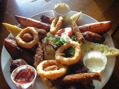 "Ultimate Combo for Two. Breaded torpedo prawns, onion rings, garlic ciabatta, jacket potato wedges, chicken wings and garlic breaded mushrooms. Plus nachos topped with cheese and salsa served with BBQ, blue cheese and sour cream dips. £7.99. Served in ""The Hungry Horse"" 05/09/11"