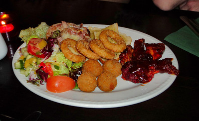 "Combo Starter - Breaded mushroom, onion rings, cheese & bacon potato shells, BBQ chicken wings and garlic bread. Served with salad garnish and dips. £7.95. Served in ""Two Mile Oak"" near Newton Abbot.     28/05/11"