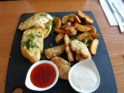 "Combo Sharer - garlic bread, potato wedges and chicken strips. Served in ""Pizzahut"" Restaurant  02/08/14"
