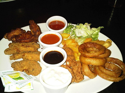 "Sharer - Spicy British chicken wings, spicy coated king prawns,southern-fried-style chicken strips, beer-battered onion rings.  Served in ""Wetherspoons""  13/02/14"