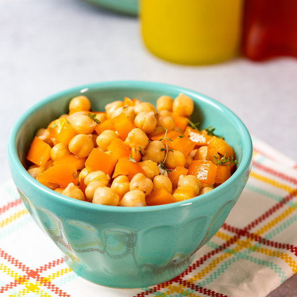 Blue bowl filled with chickpea salad.
