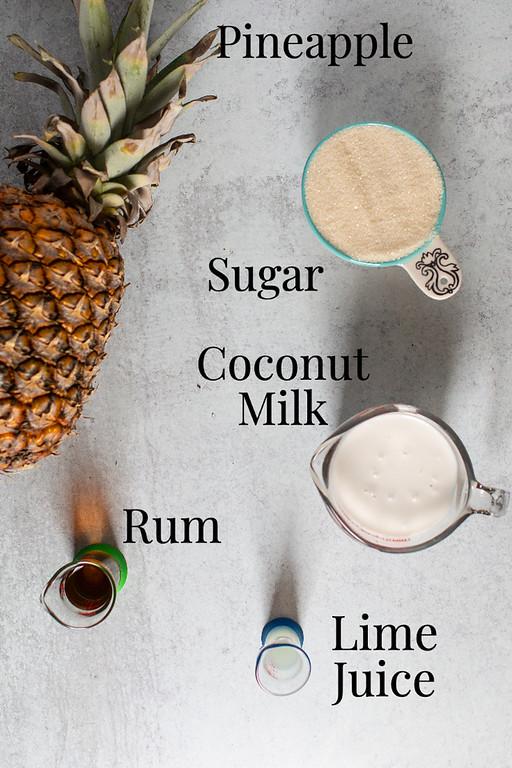 Pineapple, sugar, coconut milk, rum,  and lime juice.