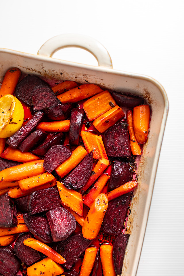Roasting pan filled with roasted beets and carrots.