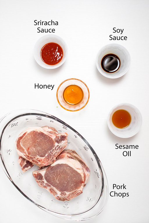Sriracha sauce, soy sauce, honey, sesame oil and pork chops.