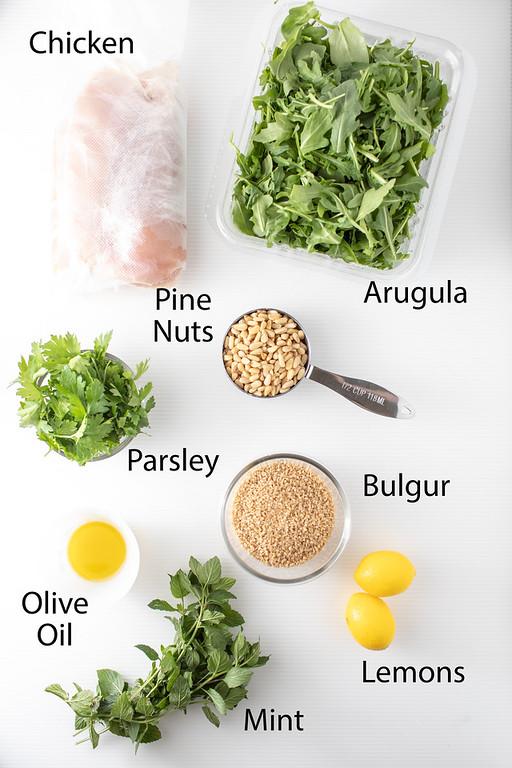 Chicken, arugula, pine nuts, parsley, bulgur, olive oil, mint, lemons to make chicken tabbouleh.