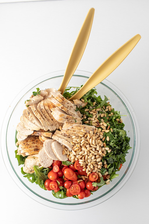 Bowl of the ingredients for chicken tabbouleh salad.
