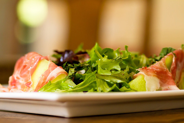 Honeydew and prosciutto with greens and mint vinaigrette