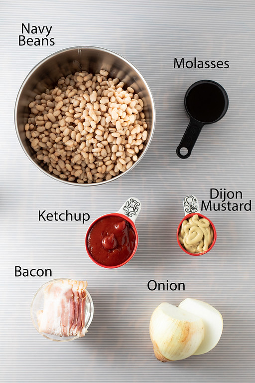Ingredients for Boston Baked Beans: navy beans, molasses, ketchup, Dijon mustard, bacon, and onions.