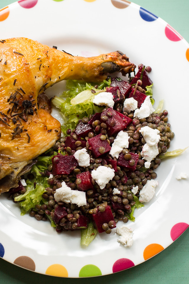 Plate with roasted chicken and a lentil salad with beets and goat cheese