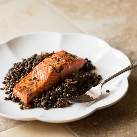 Salmon on lentils on a plate