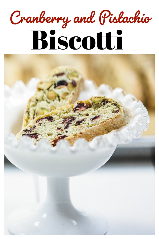 Cranberry and Pistachio biscotti in a ruffled white dish with text overlay.