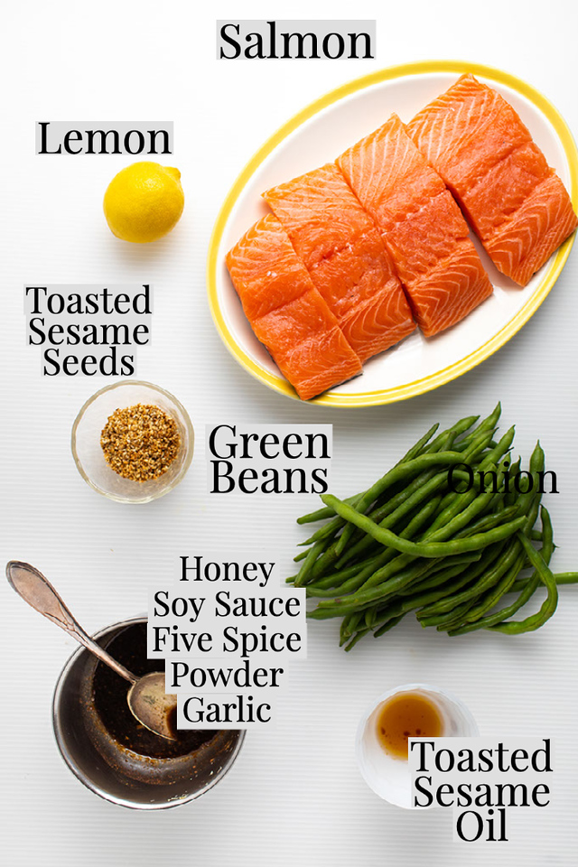 Salmon, lemon, toasted sesame seeds, green beans, toasted sesame oil and a bowl of honey & soy sauce.