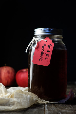Jar with tag reading apple pie moonshine