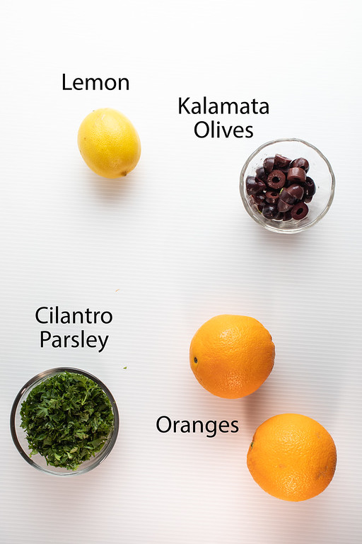 Lemon, kalamata olives, cilantro, parsley and oranges.
