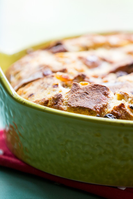 Photo of Hot Cross Buns Bread pudding in a green casserole.