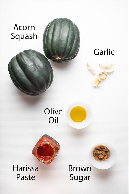 Acorn squash, garlic, olive oil, harissa paste, and brown sugar.