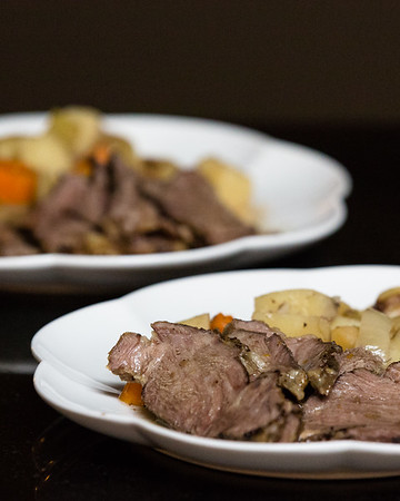 Pot roast and vegetables on a plate.