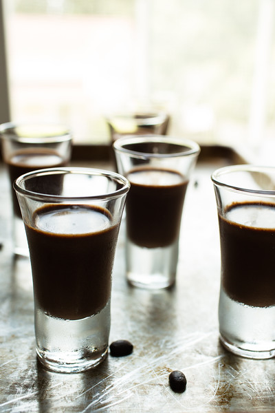 Shot glasses filled with dark chocolate espresso shots.