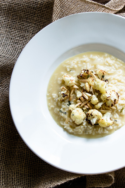 White bowl filled with cauliflower risotto.