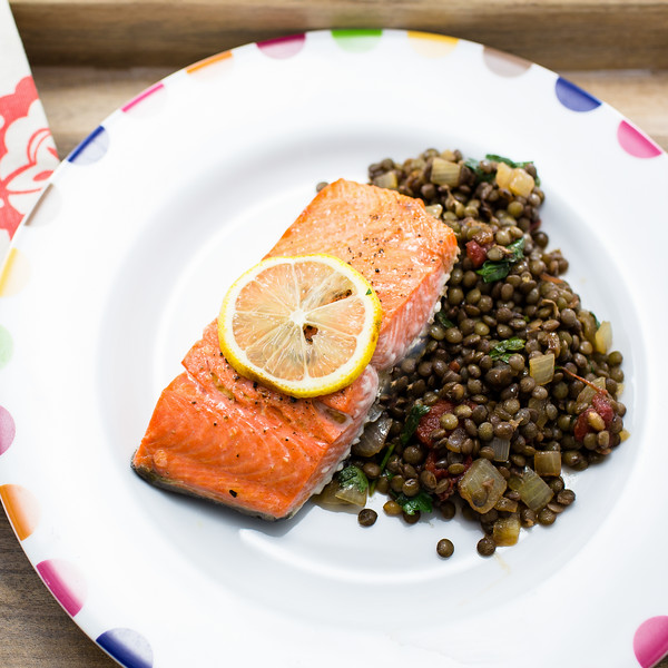 Broiled salmon on a bed of lentil salad