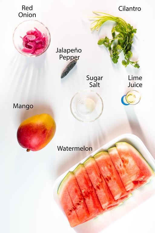 Red onions, cilantro, jalapeño pepper, sugar, salt, lime juice, mango, and watermelon.
