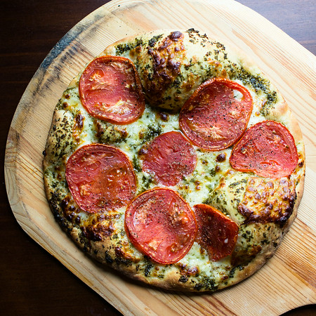 Heirloom Tomato pizza on a pizza peel