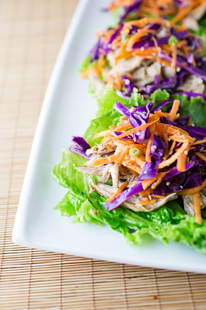 Plate of Chicken Lettuce Wraps with Brightly colored slaw