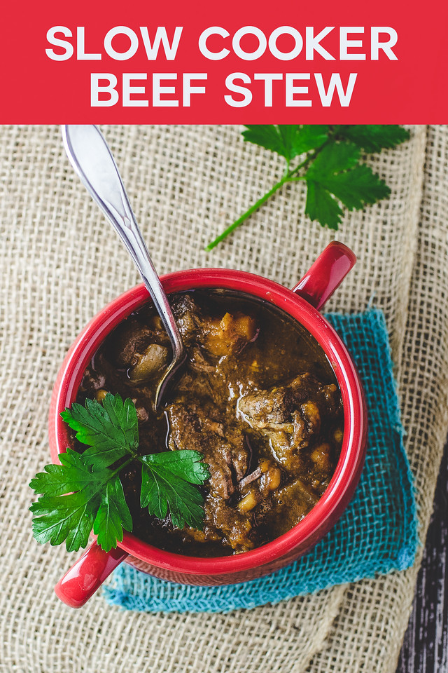 Red bowl with beef stew on a burlap background with text reading Slow Cooker Beef Stew.
