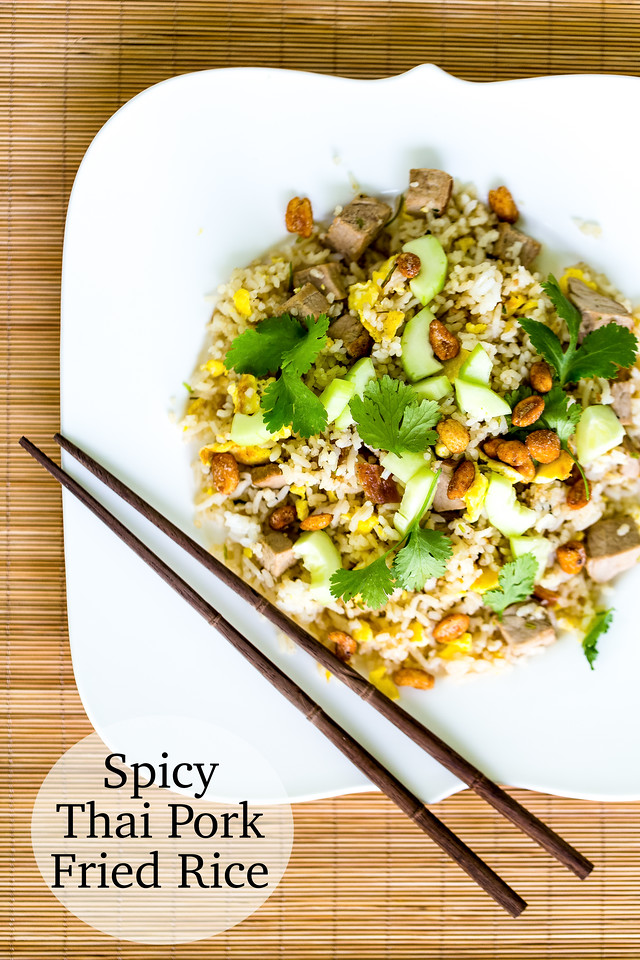 Plate of Spicy Thai Pork Fried Rice with chopsticks on a bamboo background
