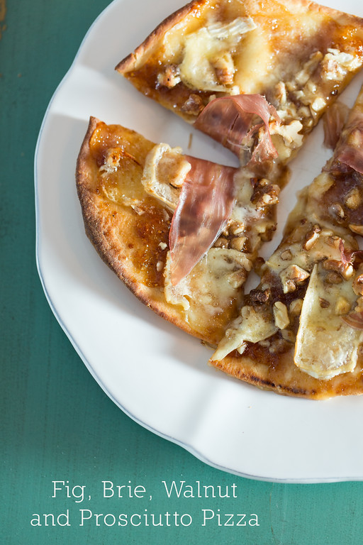 Fig, Brie, Walnut and Prosciutto pizza on a white plate!