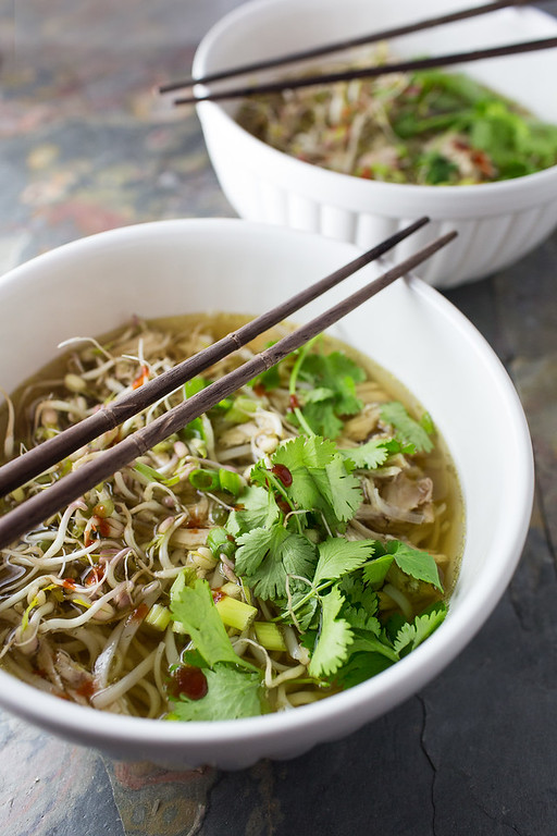 Two bowls of chicken pho