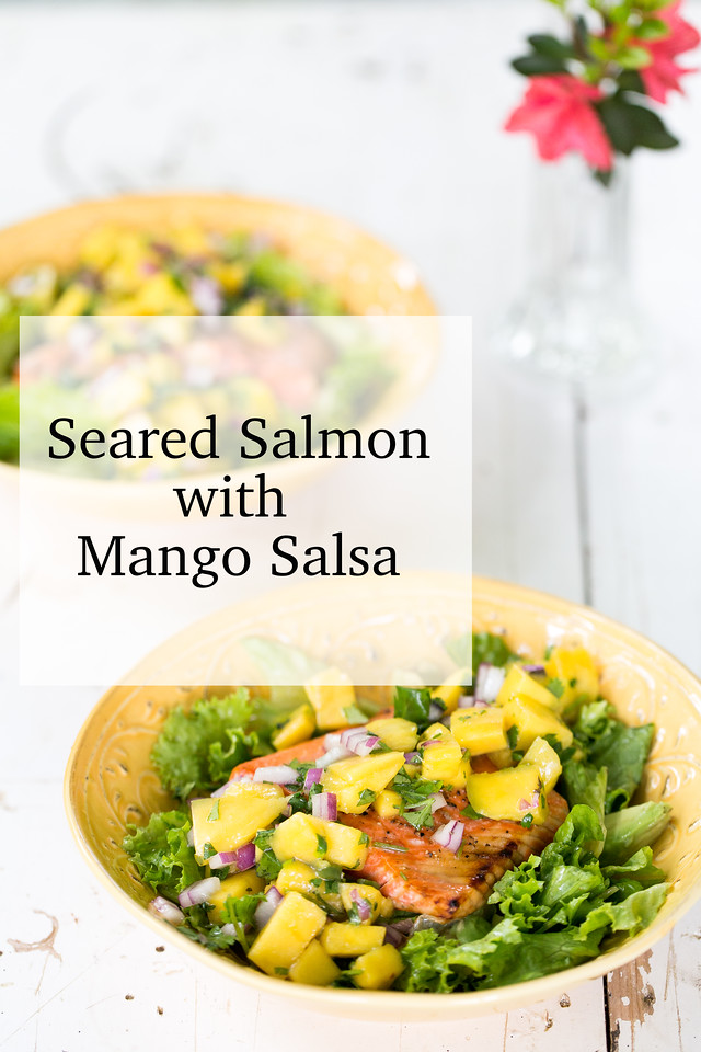 Two yellow bowls filled with seared salmon and mango salsa with text overlay reading Seared Salmon with Mango Salsa