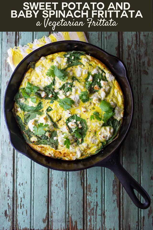 Cast iron skillet with a frittata on a rustic blue background.