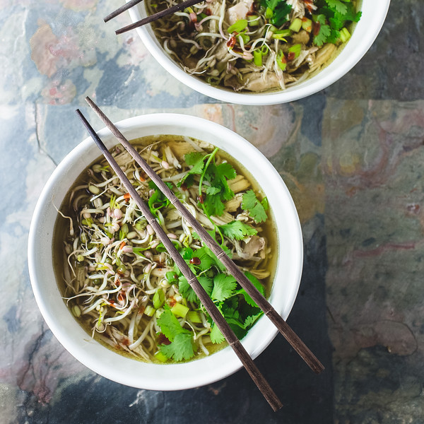 Two bowls of Crock Pot Chicken pho with chop sticks