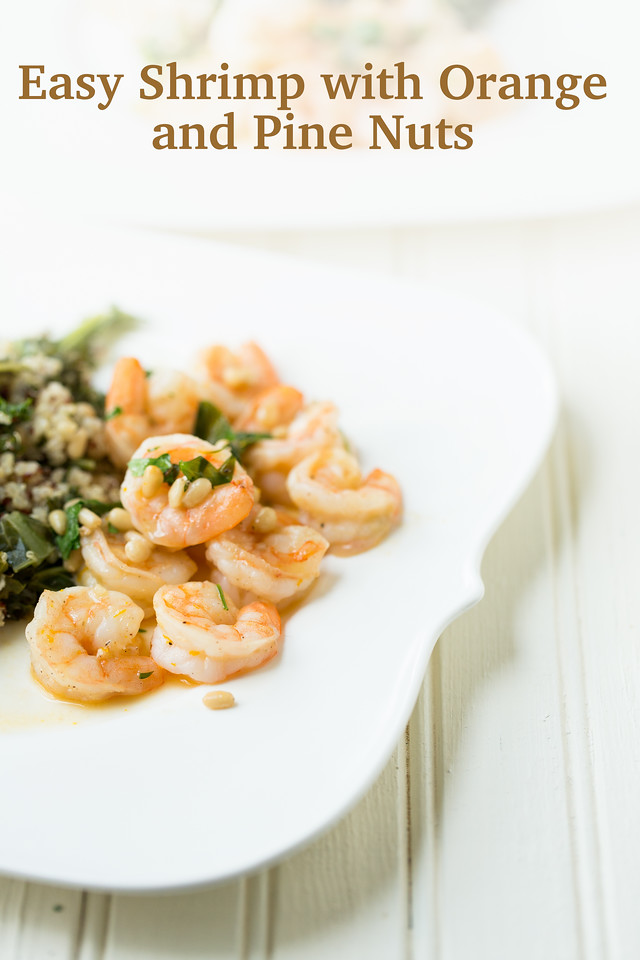 Easy Shrimp with Orange and Pine Nuts on a plate of shrimp with pine nuts