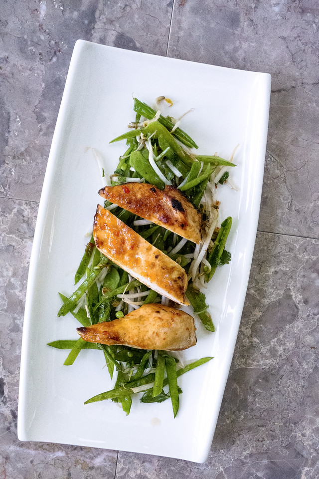 Plate with chicken and a salad