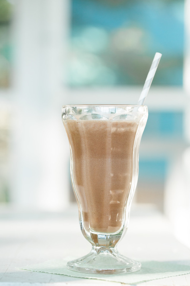 Glass filled with chocolate smoothie