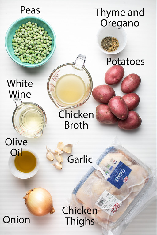 Ingredients to make chicken vesuvio: peas, thyme & oregano, potatoes, chicken broth, white wine, olive oil, garlic, onion and chicken thighs.