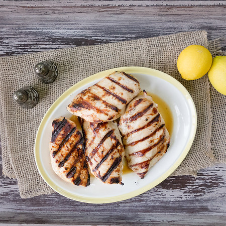 Plate of lemon grilled chicken breasts