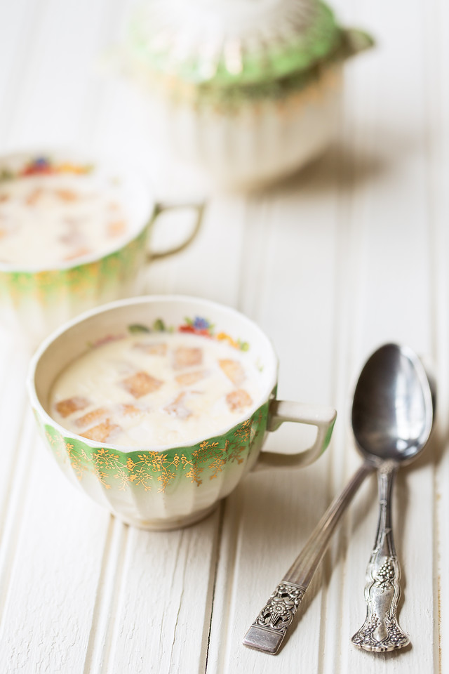 Bead board with vintage teacups filled with a panna cotta and vintage teaspoons