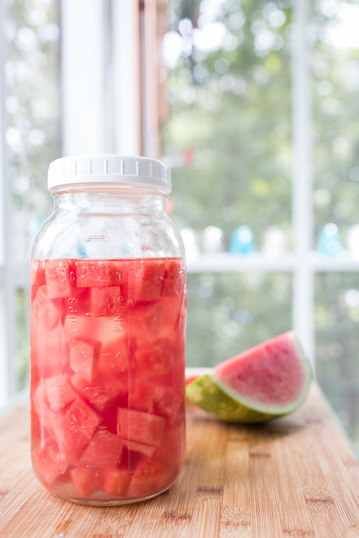 Jar filled with tequila and watermelon.