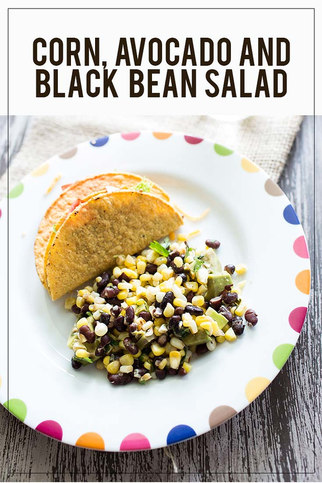 Corn, Avocado and Black Bean Salad on a white plate with colored half circles