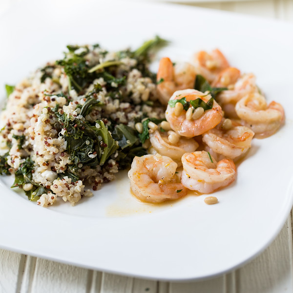Plate of cooked shrimp and grain salad
