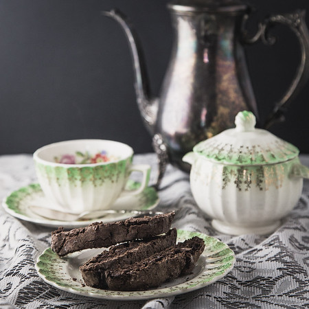 Double chocolate biscotti with old tea set.