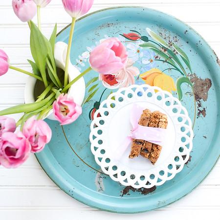 Plate of hazelnut and apricot biscotti on a vintage blue tray