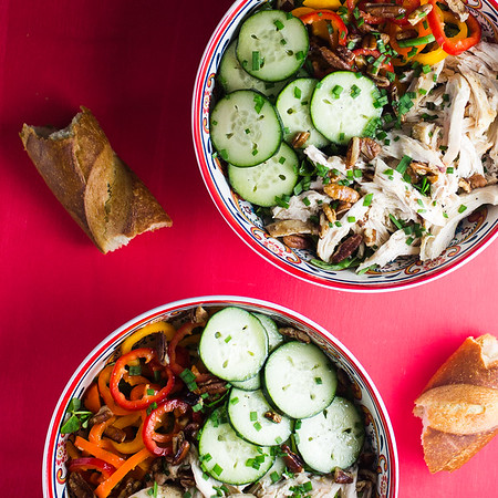 Two bowls of Chicken, Cucumbers and Sweet Peppers
