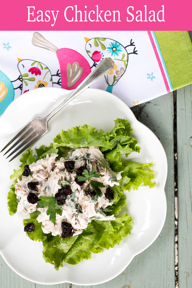 Plate of chicken salad on a blue background with the words easy chicken salad on a pink overlay