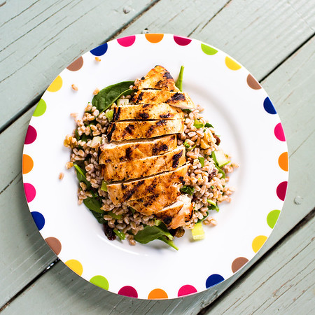 Plate of grilled chicken with farro salad